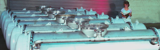 Header image of a multiple shell and tube heat exchangers